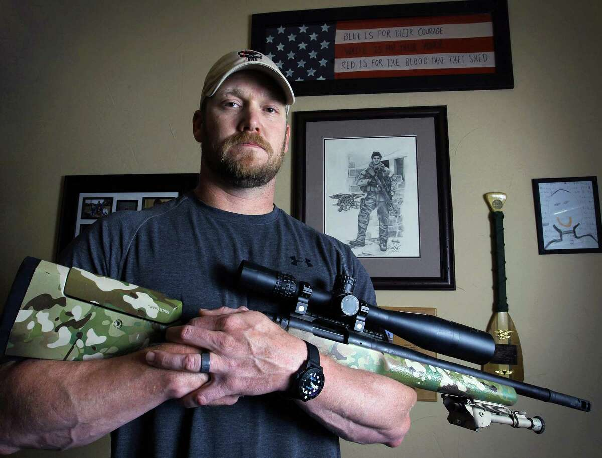 "In this April 6, 2012 file photo, Chris Kyle, a former Navy SEAL and author of the book ""American Sniper,"" poses in Midlothian, Texas. Kyle and his friend Chad Littlefield were fatally shot at a shooting range southwest of Fort Worth, Texas, on Saturday, Feb. 2, 2013. Former Marine Eddie Ray Routh, who came with them to the range, has been arrested for the murders. (AP Photo/The Fort Worth Star-Telegram, Paul Moseley, File)"