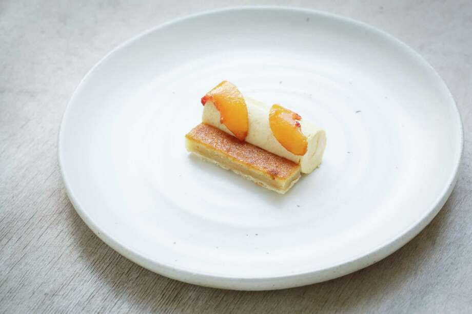 Peach 'bakewell' tart with frozen peach mousse at Oxheart Restaurant. Photo: Michael Paulsen, Houston Chronicle / © 2013 Houston Chronicle
