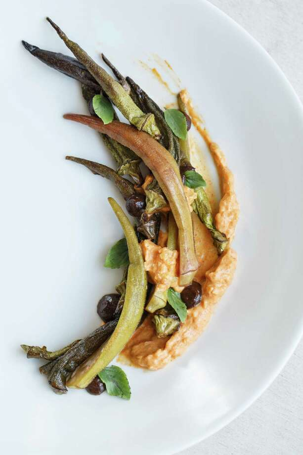 Slowly roasted and pickled okra, with smoked black garlic, creme fraiche, and 'african blue' basil at Oxheart Restaurant. Photo: Michael Paulsen, Houston Chronicle / © 2013 Houston Chronicle