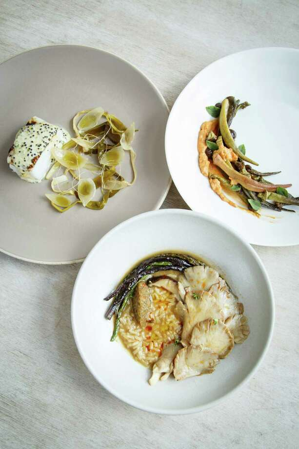 Gulf 'yellow edge' grouper roasted over pecan wood, spring onion escabeche, three egg sauce, caviar (left clockwise), slowly roasted and pickled okra, with smoked black garlic, creme fraiche, and 'african blue' basil, and a stew of cultivated mushrooms and texas rice, with caramelized sauerkraut charred long beans, and sweet peppers. Photo: Michael Paulsen, Houston Chronicle / © 2013 Houston Chronicle