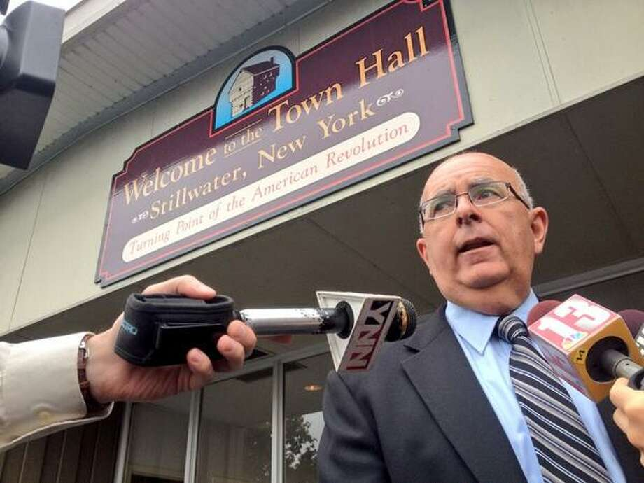 Mike Zurlo speaks to reporters Tuesday after voting in the primary for Saratoga County sheriff. Zurlo, a lieutenant in the sheriff's department faces retired State Police Investigator Jeff Gildersleeve in the primary. The two men are vying to succeed James Bowen who has been sherff since the 1970s. (Cindy Schultz / Times Union)
