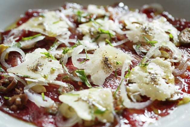 "Carpaccio (kar-PAH-chee-oh): Thinly shaved raw meat usually served as an appetizer. Audio: Click here to hear the term ""Carpaccio."" Photo: Michael Paulsen, Houston Chronicle / © 2013 Houston Chronicle"