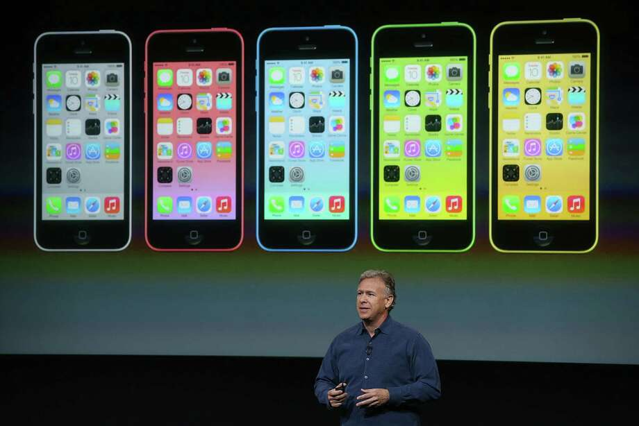 Apple Senior Vice President of Worldwide Marketing Phil Schiller speaks about the new iPhone 5C during an Apple product announcement at the Apple campus on September 10, 2013 in Cupertino, California. The company launched the new iPhone 5C model that will run iOS 7 is made from hard-coated polycarbonate and comes in various colors. Photo: Justin Sullivan, Getty Images / 2013 Getty Images