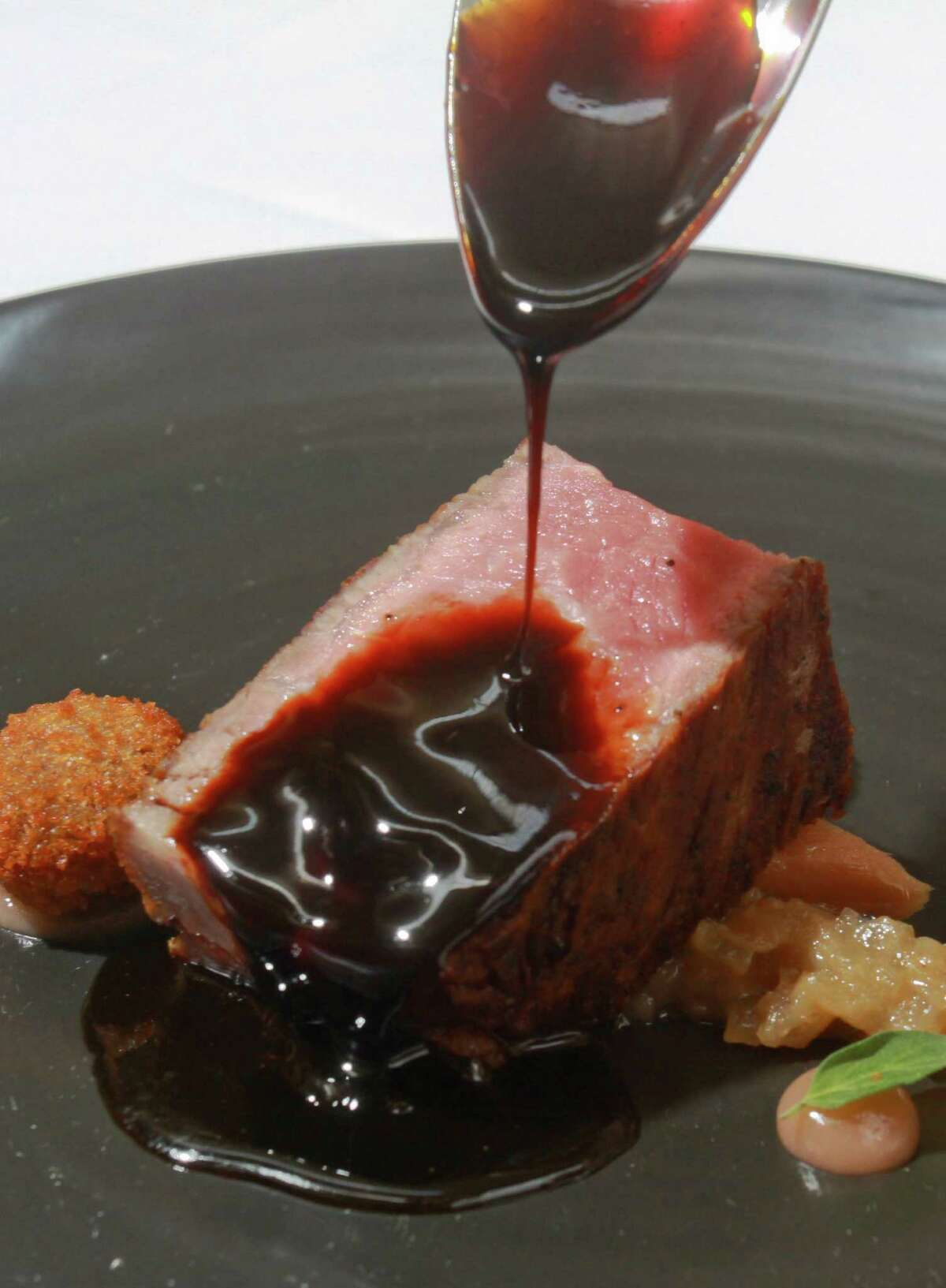 Bistecca with Rhubarb, and Balsamic Beef Jus added at table side, prepared by chef Grant Gordan at Tony's.