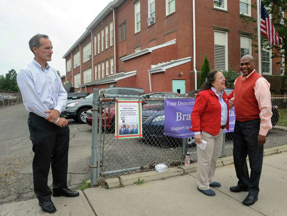 Pete Spain, Rose Rodrigues and school board candidate Andre Baker campaign outside Black Rock School in Bridgeport, Conn. on Tuesday Sept. 10, 2013. Photo: Cathy Zuraw / Connecticut Post
