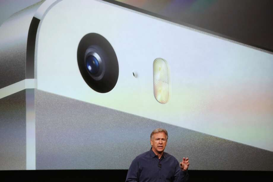Apple Senior Vice President of Worldwide Marketing at Phil Schiller speaks about the new iPhone 5S during an Apple product announcement at the Apple campus on September 10, 2013 in Cupertino, California. The company launched two new iPhone models that will run iOS 7. The 5C is made from a hard-coated polycarbonate and comes in five colors. The 5S comes in three colors and contains an A7 chip. Photo: Justin Sullivan, Getty Images