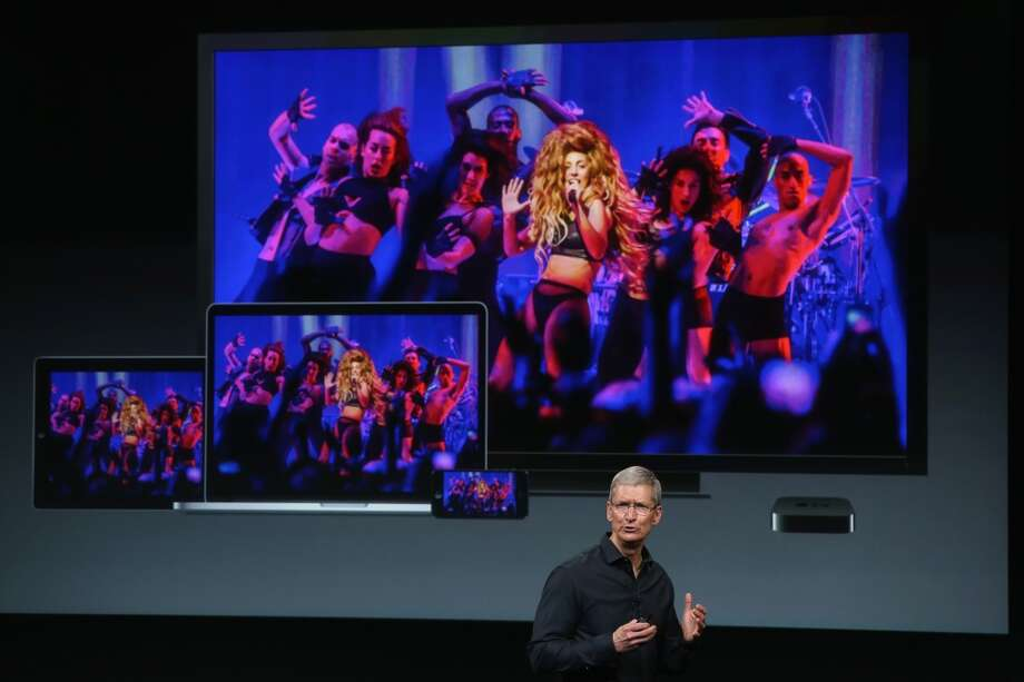Apple CEO Tim Cook speaks about the iTunes music festival on stage during an Apple product announcement at the Apple campus on September 10, 2013 in Cupertino, California. The company is expected to launch at least one new iPhone model. Photo: Justin Sullivan, Getty Images