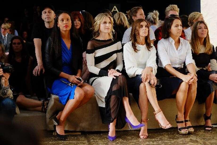 Joy Bryant, Ali Larter and Carine Roitfeld attend the Donna Karan fashion show. Photo: Neilson Barnard, Getty