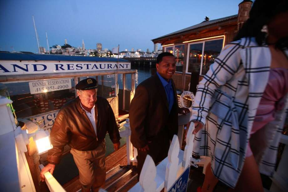 Mr. Forbes (behind) welcoming visitors. Photo: Liz Hafalia, San Francisco Chronicle