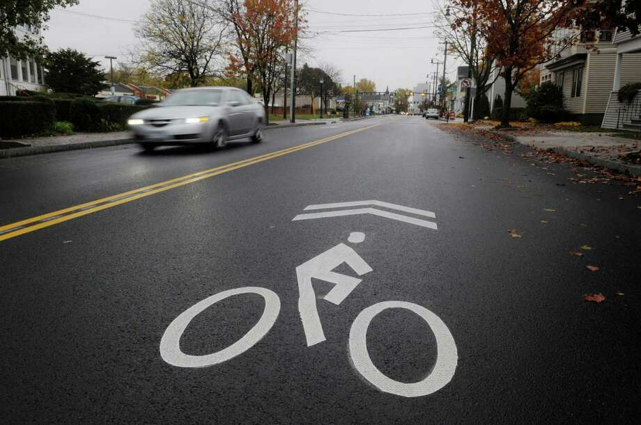 Signs posted along Delaware Avenue  and markings on the road are there to tell motorists that they have to share the full lane with bicyclist riders, as seen here on Wednesday, Oct. 27, 2010.   (Paul Buckowski / Times Union) Photo: Paul Buckowski