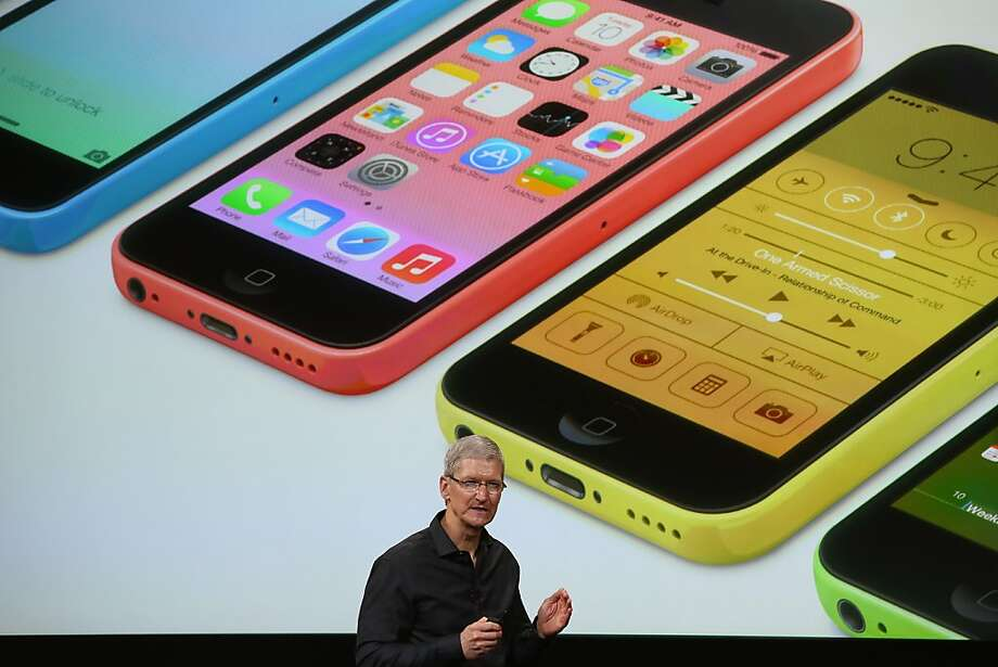 Apple CEO Tim Cook introduces the iPhone 5C, which will come in five colors, at the company's Cupertino headquarters. Photo: Justin Sullivan, Getty Images