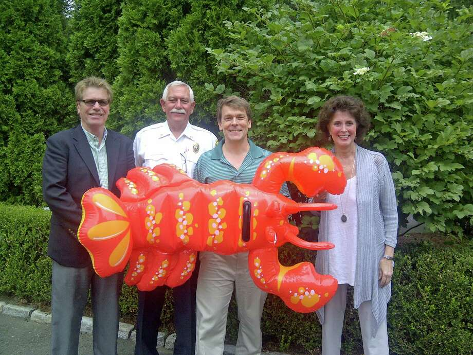The Rotary Club of New Canaan is holding its 28th annual New Canaan Family Lobsterfest on Sept. 20 and 21. Above, joining the Lobsterfest mascot, are New Canaan Rotary members Eric Fjeldal, Fred Baker, Scott Hobbs and Carolyn Clark. Photo: Contributed Photo