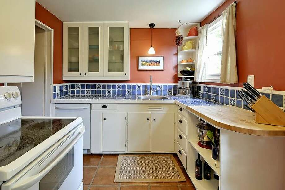 Kitchen of 6558 16th Ave. S.W. It's listed for $250,000. Photo: Courtesy Jody Baker, Windermere Real Estate