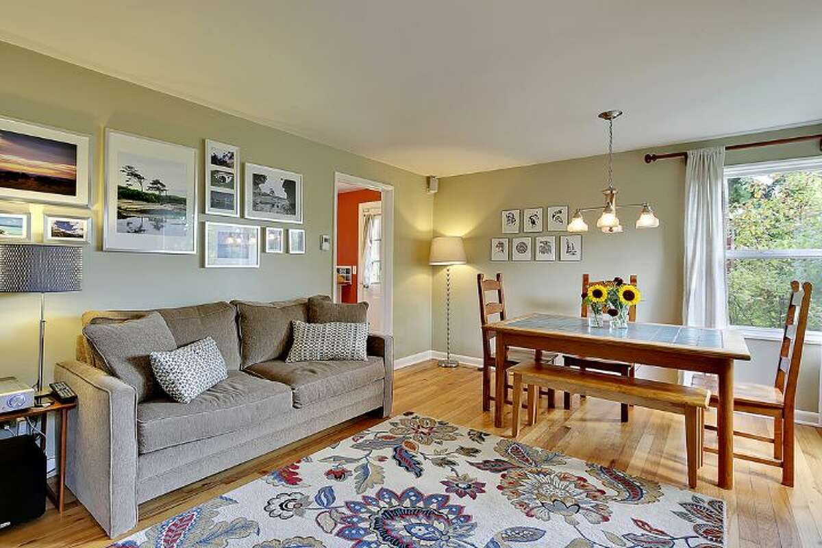 Living and dining room of 6558 16th Ave. S.W. It's listed for $250,000.