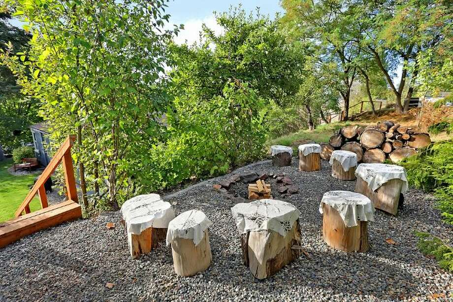 Fire pit of 6558 16th Ave. S.W. It's listed for $250,000. Photo: Courtesy Jody Baker, Windermere Real Estate