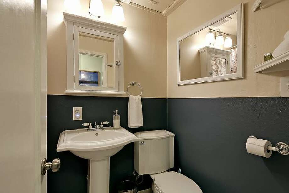 Bathroom of 6558 16th Ave. S.W. It's listed for $250,000. Photo: Courtesy Jody Baker, Windermere Real Estate