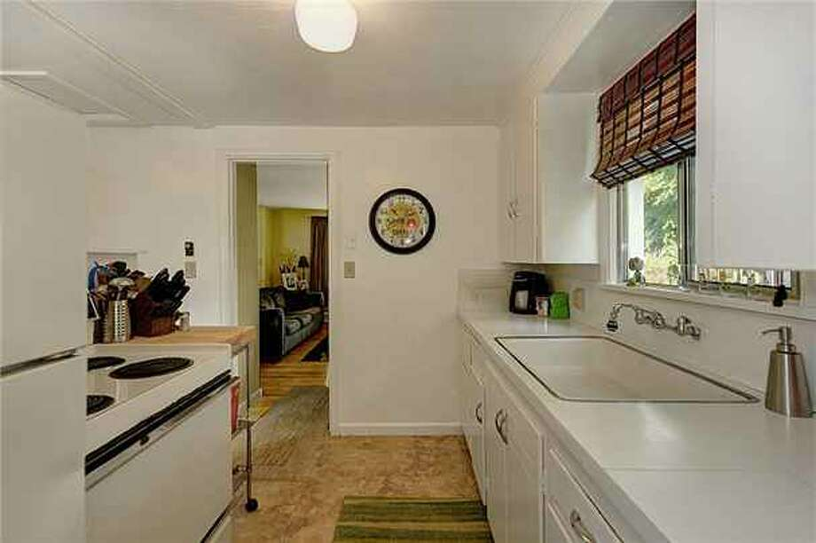 Kitchen of 1419 S.W. Cambridge St. It's listed for $265,000. Photo: Courtesy Gini Johnson, Prudential Northwest Realty Associates