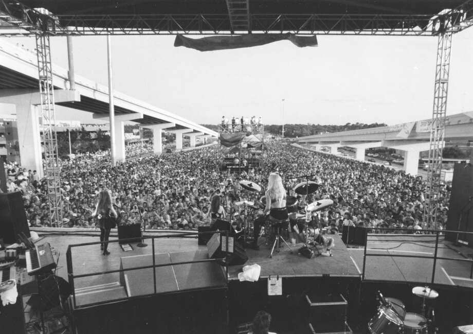 My first concert was the Bangles, at a celebration of the opening of the Sam Houston Tollway in 1989. The concert was on the freeway, jam-packed, and I was a terrified 9-year-old who couldn't take the massive crowd. My uncle, sisters and I climbed along the side of the freeway (don't look down) just to escape the crowd and watch from the back. Stephanie DiCapua Getman Photo: Kerwin Plevka, Houston Chronicle