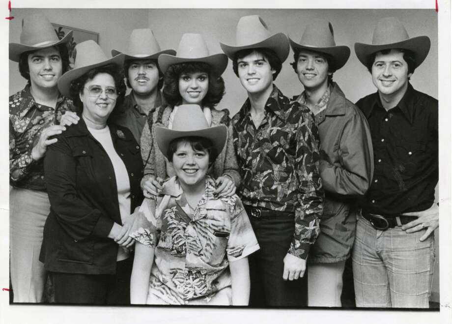 I saw the Osmonds Brothers -- my first real crush was Donny -- in 1975 at the Houston Livestock Show and Rodeo (whole family pictured here at the 1977 rodeo)  and John Denver -- the love of my young life -- in the spring of 1980 at the Lake Charles Civic Center.
