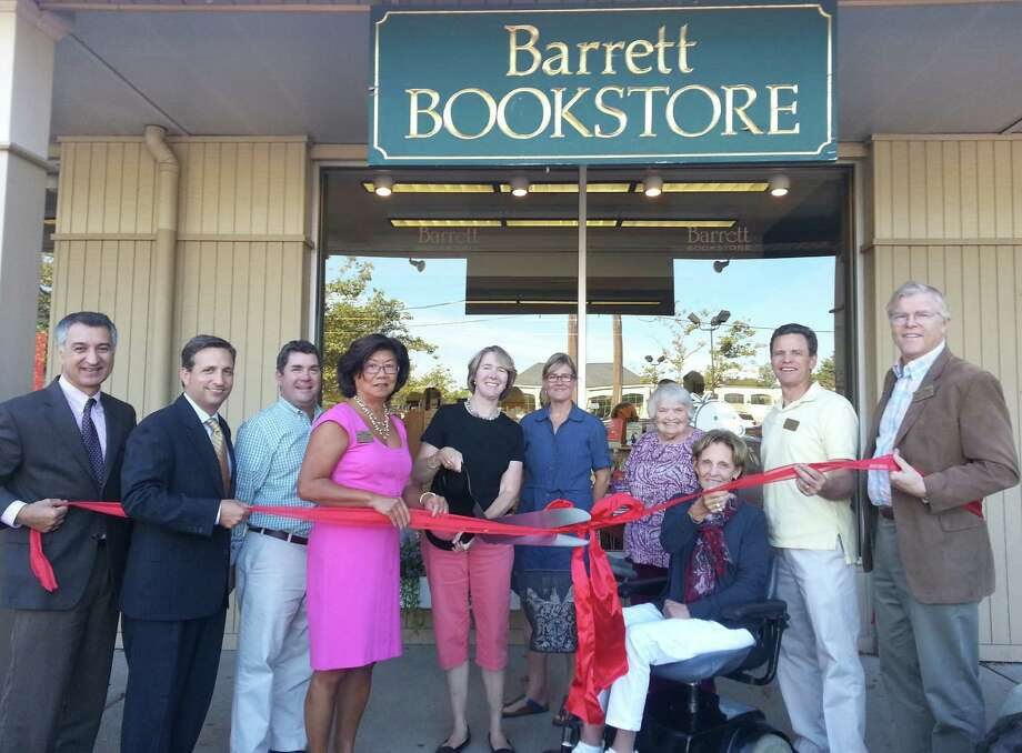 At the ribbon-cutting ceremony for the newly renovated Barrett Bookstore in Darien on Saturday, Sept. 7, were, from left, state Sens. Carlo Leone and Bob Duff,;Greg Palmer of Palmerís Market; Kaye Leong of Darien Rowayton Bank and the Darien Chamber of Commerce board; Barrett Bookstore employees  Libby Stowell, Rosanna Nissen and Dottie Brush; Barrett Bookstore owner Shelia Daley; Casey Hart of The Informer and the Darien Chamber of Commerce board; and Selectman John Lundeen of Lundeen Cliffside Associates and the Darien Chamber of Commerce board. Photo: Contributed