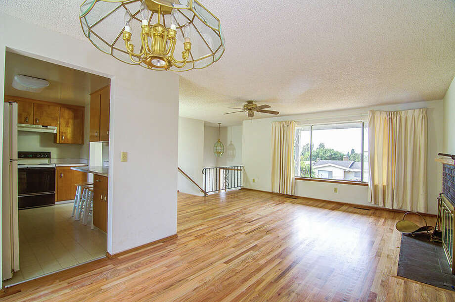 Dining and living rooms of 9424 10th Ave. S.W. It's listed for $289,950. Photo: Courtesy Rocky Gabay, Warring Properties