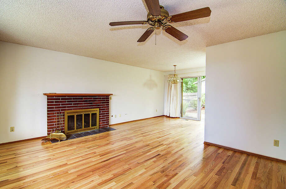 Living and dining rooms of 9424 10th Ave. S.W. It's listed for $289,950. Photo: Courtesy Rocky Gabay, Warring Properties