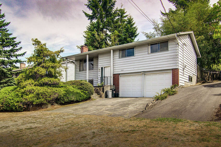 Next comes 9424 10th Ave. S.W. The 1,720-square-foot house, built in 1963, has three bedrooms, one bathroom, two powder rooms, two fireplaces, a wood-paneled rec room and a shop on a 7,620-square-foot lot. It's listed for $289,950. Photo: Courtesy Rocky Gabay, Warring Properties