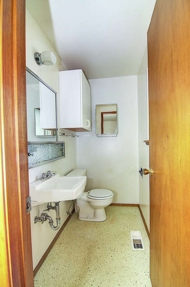 Powder room of 9424 10th Ave. S.W. It's listed for $289,950. Photo: Courtesy Rocky Gabay, Warring Properties