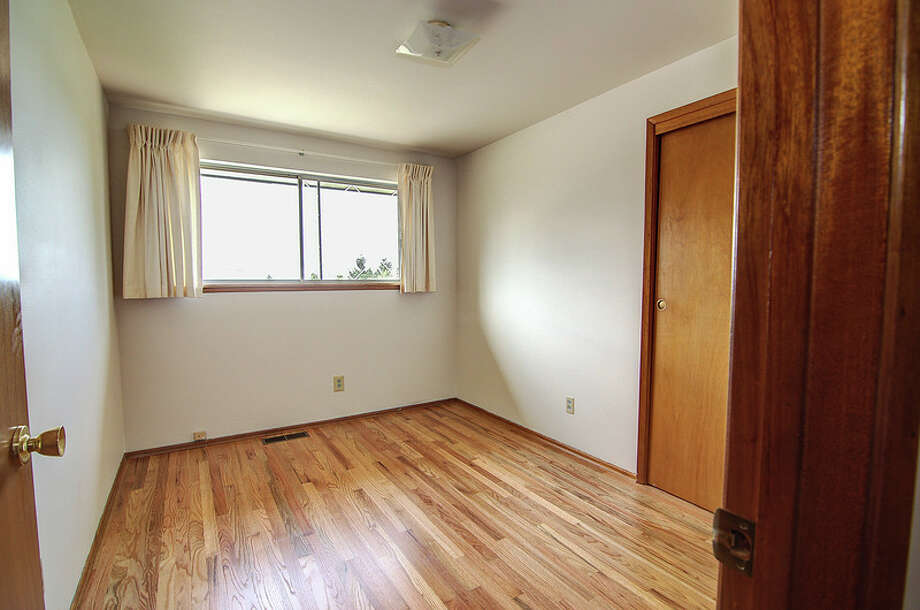 Bedroom of 9424 10th Ave. S.W. It's listed for $289,950. Photo: Courtesy Rocky Gabay, Warring Properties