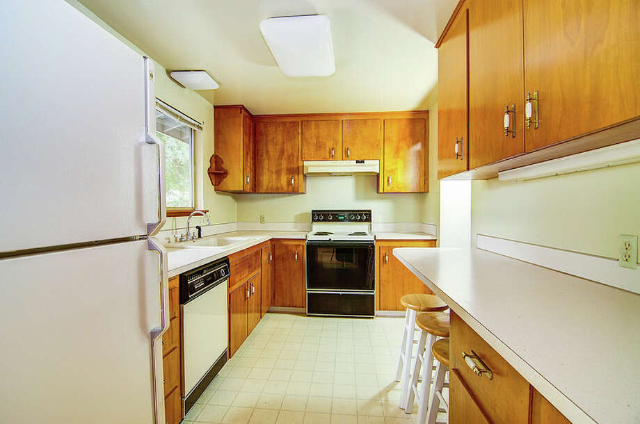Kitchen of 9424 10th Ave. S.W. It's listed for $289,950. Photo: Courtesy Rocky Gabay, Warring Properties