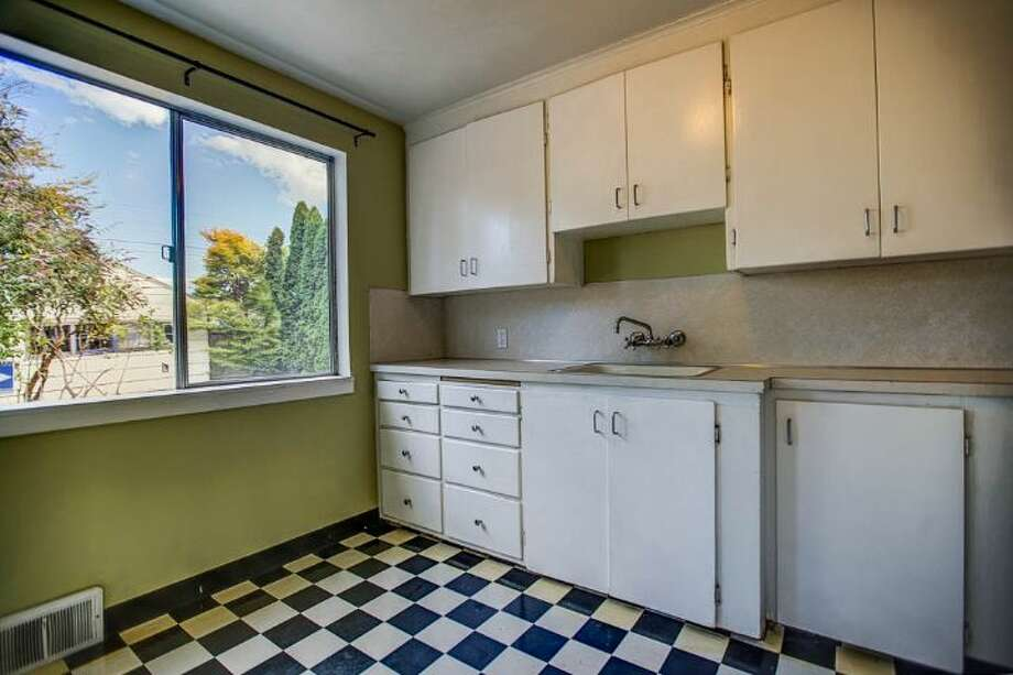 Kitchen of 7146 31st Ave. S.W. It's listed for $299,000. Photo: Courtesy Ben Carr, Windermere Real Estate