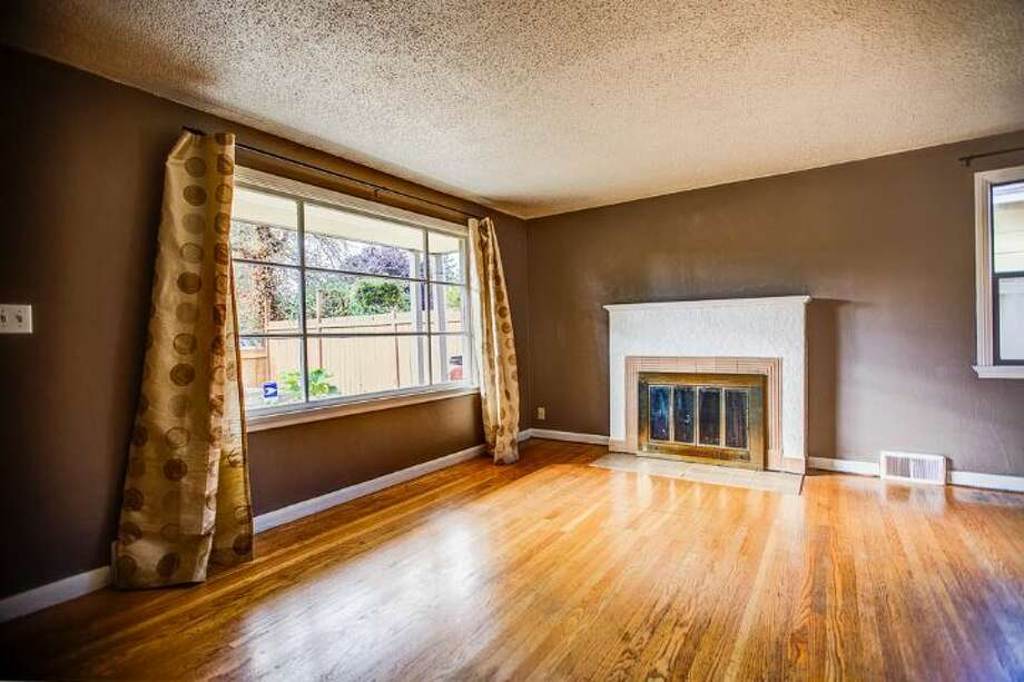 Living room of 7146 31st Ave. S.W. It's listed for $299,000. Photo: Courtesy Ben Carr, Windermere Real Estate