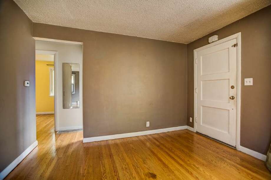 Entry of 7146 31st Ave. S.W. It's listed for $299,000. Photo: Courtesy Ben Carr, Windermere Real Estate