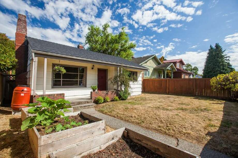Finally, here's 7146 31st Ave. S.W. The 710-square-foot home, built in 1942, has two bedrooms, one bathroom, fenced front and back yards, raised beds and a detached garage/shop on a 5,140-square-foot lot. It's listed for $299,000. Photo: Courtesy Ben Carr, Windermere Real Estate