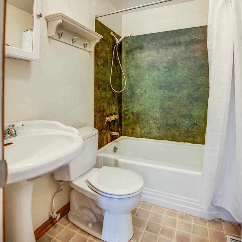 Bathroom of 7146 31st Ave. S.W. It's listed for $299,000. Photo: Courtesy Ben Carr, Windermere Real Estate