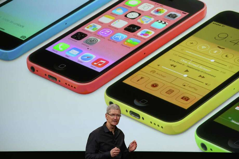 Apple CEO Tim Cook speaks about the new iPhone during an Apple product announcement at the Apple campus on September 10, 2013 in Cupertino, California. The company launched two new iPhone models that will run iOS 7. The 5C is made from a hard-coated polycarbonate and comes in five colors. The 5S comes in three colors, features a fingerprint sensor, has an upgraded camera, and contains an A7 chip. Photo: Justin Sullivan, Getty Images / 2013 Getty Images