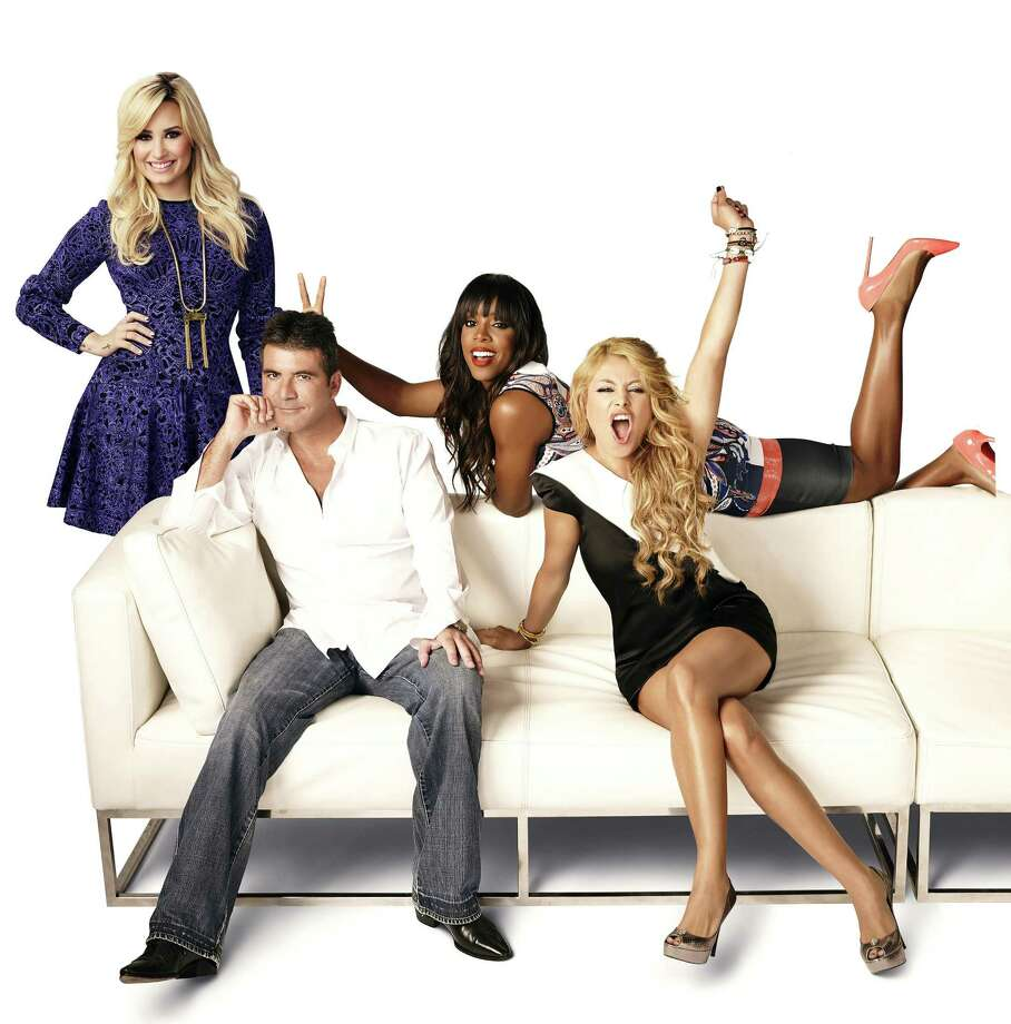 "Demi Lovato (from left), Simon Cowell, Kelly Rowland and Paulina Rubio radiate enthusiasm as ""The X Factor"" judges. Photo: Fox"