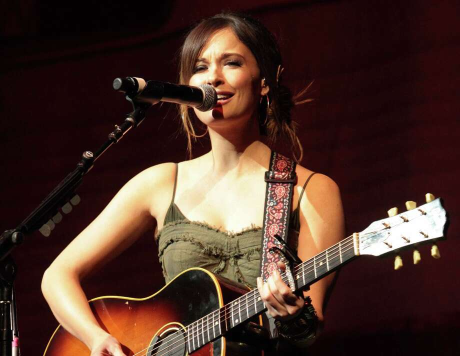 """FILE - In this March 3, 2013 file photo, country music artist Kacey Musgraves performs at the American Music Theatre in Lancaster, Pa. Musgraves and Taylor Swift top the list of final nominees for """"The 47th Annual CMA Awards"""" with six nominations each. The awards show will be hosted for the sixth time by Brad Paisley and Carrie Underwood and will be broadcast live from the Bridgestone Arena in Nashville, Wednesday, Nov. 6 on the ABC.  (Photo by Owen Sweeney/Invision/AP, File) ORG XMIT: NY111 Photo: Owen Sweeney / Invision"""
