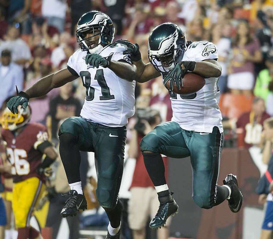 Receiver Jason Avant (left) helps running back LeSean McCoy celebrate his touchdown Monday night, when the new-look Eagles offense appeared impressive in coach Chip Kelly's debut. Photo: Harry E. Walker, McClatchy-Tribune News Service
