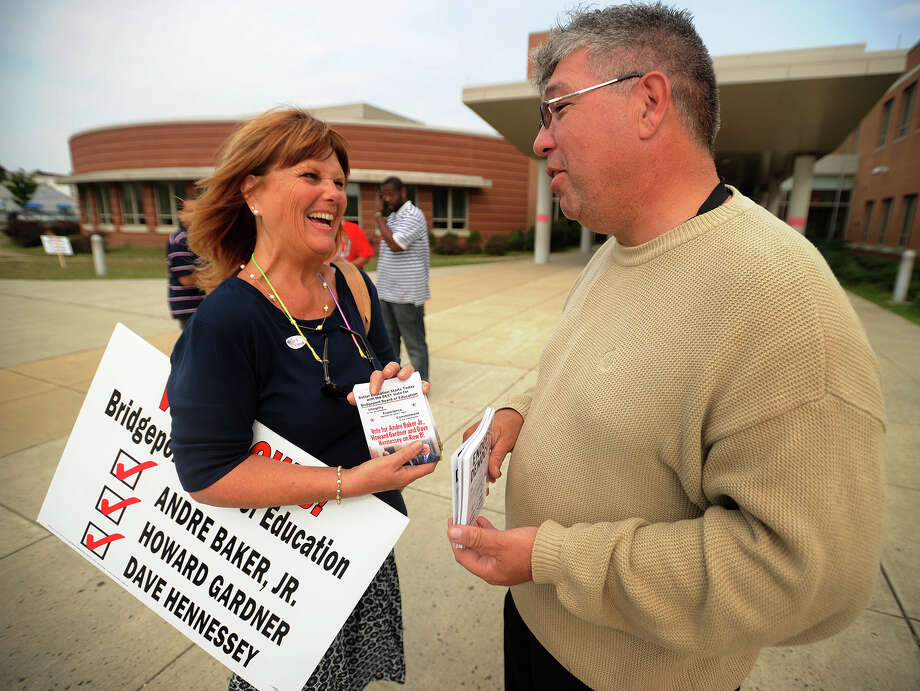Lynda Bluestein, supporting Board of Education Row B candidates, and Max Perez, supporting Row A, chat outside the primary polling place at Cesar Batalla School in Bridgeport, Conn. on Tuesday, September 10, 2013. Photo: Brian A. Pounds / Connecticut Post
