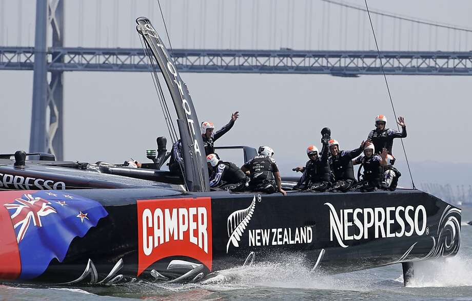 The Emirates Team New Zealand crew had reason to smile after Race 5  as it continued its run of success on San Francisco Bay. The Kiwis now need just more five victories to claim the America's Cup. Photo: Eric Risberg, Associated Press