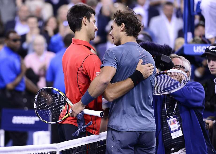 Rafal Nadal, right, and Novak Djokovic embrace after Monday's U.S. Open final. Photo: Ben Solomon, New York Times