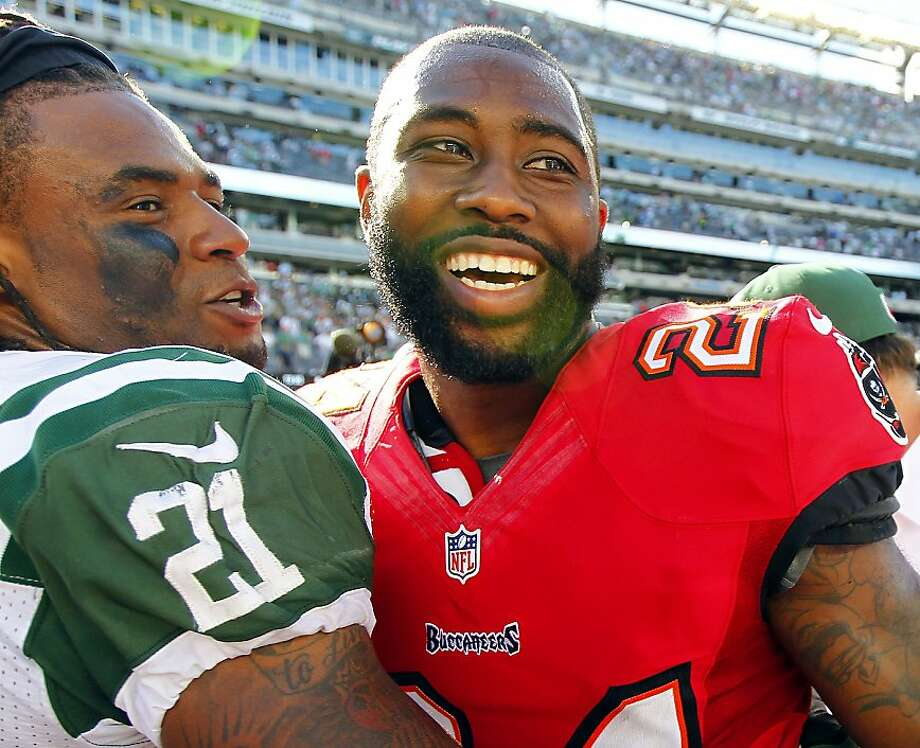 EAST RUTHERFORD, NJ - SEPTEMBER 8: Corner back Ellis Lankster #21 of the New York Jets laughs with former teammate cornerback Darrelle Revis #24 of the Tampa Bay Buccaneers after their game at MetLife Stadium on September 8, 2013 in East Rutherford, New Jersey. The Jets defeated the Bucs 18-17. (Photo by Rich Schultz /Getty Images) Photo: Rich Schultz, Getty Images
