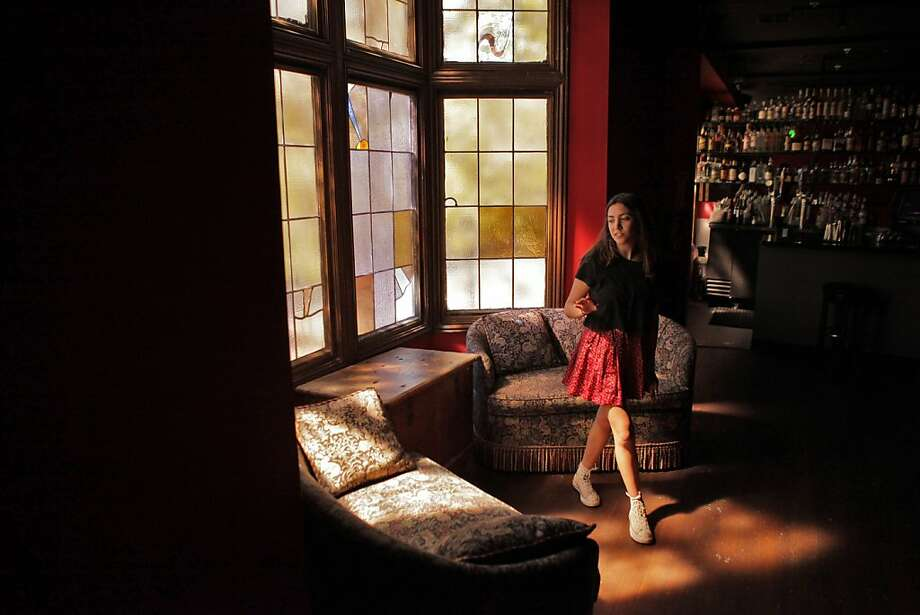 Alex Lilienfeld walks by victorian couches that sit near a set of leaded glass bay window in the mezzanine at The Chapel on Monday, September 9, 2013, in San Francisco, Calif.The Chapel is a new nightclub and restaurant in the Mission District and the creation of Jack Knowles. Knowles took original materials like leaded glass windows and wood beams from the former mortuary and recreated the essence of the original space. Photo: Carlos Avila Gonzalez, The Chronicle