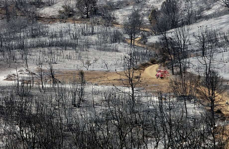 A Cal Fire engine navigates a dirt road on the burned hillside of Mount Diablo close to the summit. Photo: Michael Macor, The Chronicle