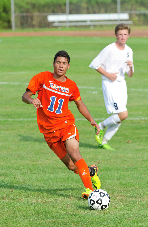 Danbury's Grimaldo DeSousa (11) controls the ball during the boys soccer game against Staples at Staples High School in Westport on Tuesday, Sept. 10, 2013. Photo: Amy Mortensen / Connecticut Post Freelance