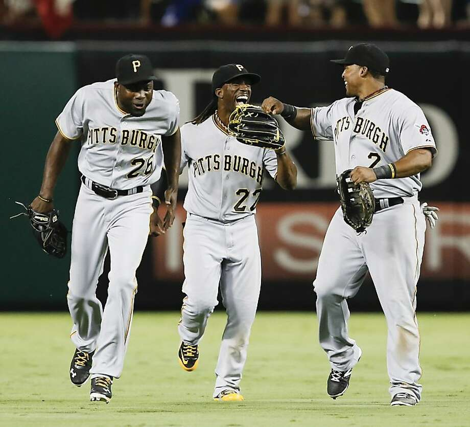 Pirates outfielders Felix Pie (left), Andrew McCutchen and Marlon Byrd celebrate win No. 82. Photo: Jim Cowsert, Associated Press
