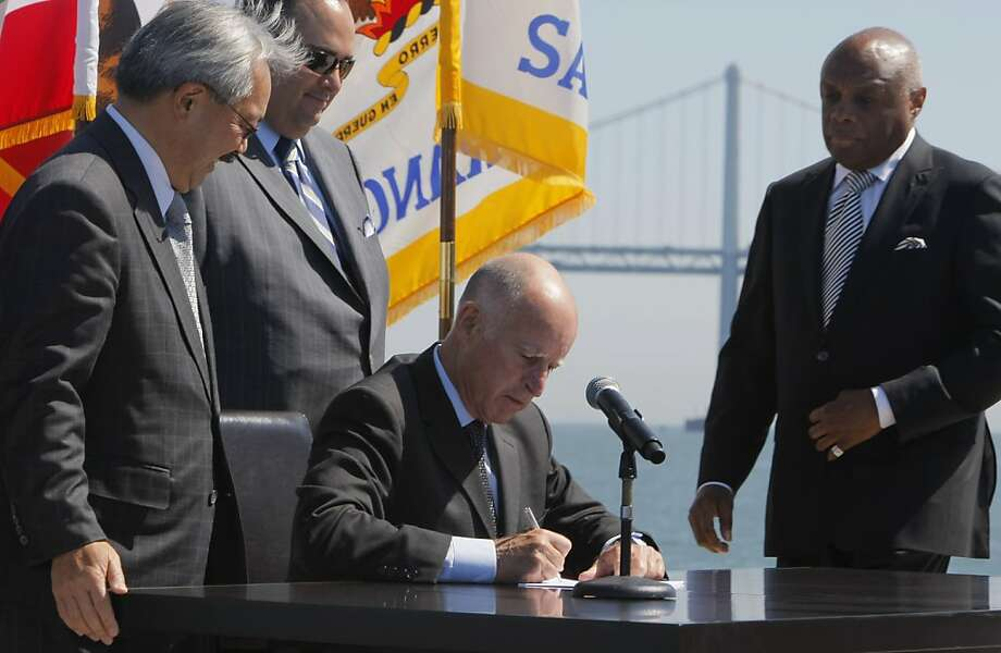Willie Brown watches Gov. Jerry Brown sign an infrastructure bill in 2011. Photo: Thomas Webb, The Chronicle