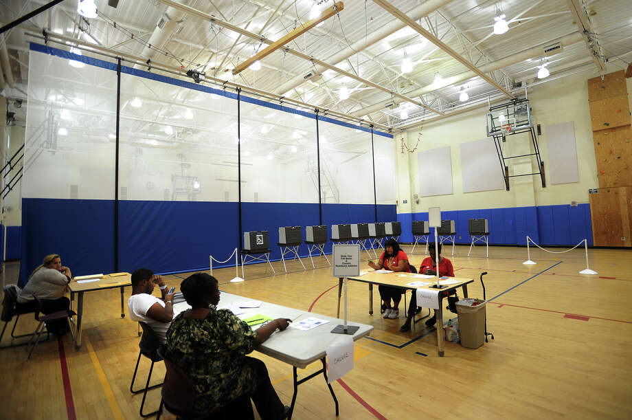 Poll workers wait for voters during light primary turnout at Cesar Batalla School in Bridgeport, Conn. on Tuesday, September 10, 2013. Photo: Brian A. Pounds / Connecticut Post