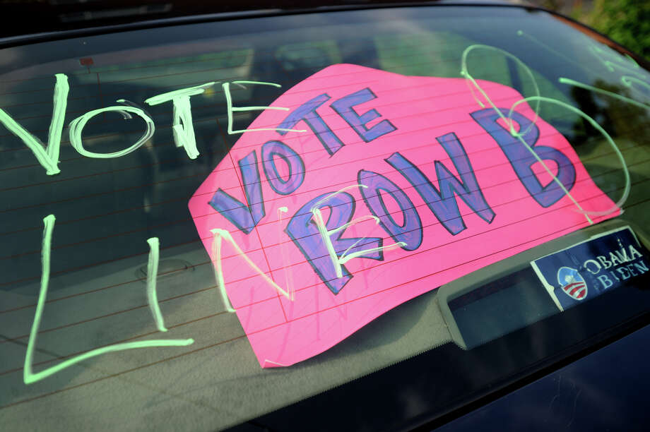 A car rear window outside the primary polling place at Central High School in Bridgeport, Conn. on Tuesday, September 10, 2013. Photo: Brian A. Pounds / Connecticut Post